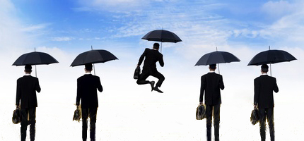 happy businessman jumping umbrella