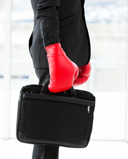 businessman wearing suit and boxing gloves