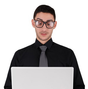 man stock reviewer inspecting computer laptop